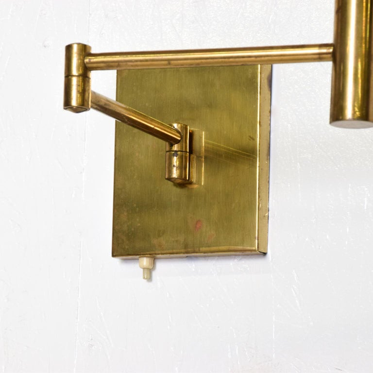 For your consideration, a pair of brass wall sconces, After Lightolier, Mid-Century Modern era. Articulated arm can be adjusted in almost any direction. No bulb or shades included. Dimensions: 17 1/2