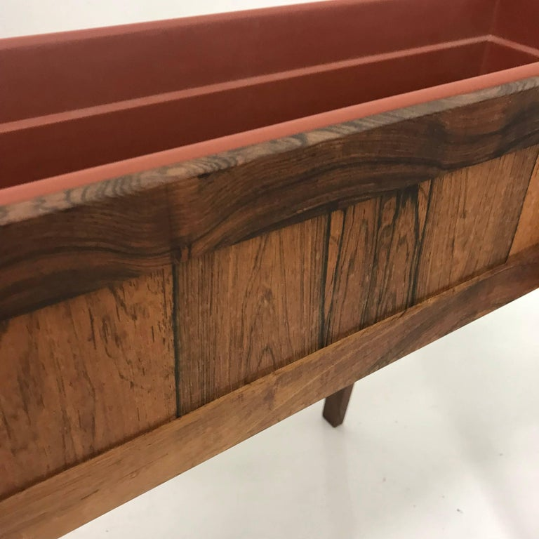 For your consideration, a Mid-Century Modern Brazilian rosewood planter. Made in Denmark, circa the 1960s. Dimensions: 19 3/4