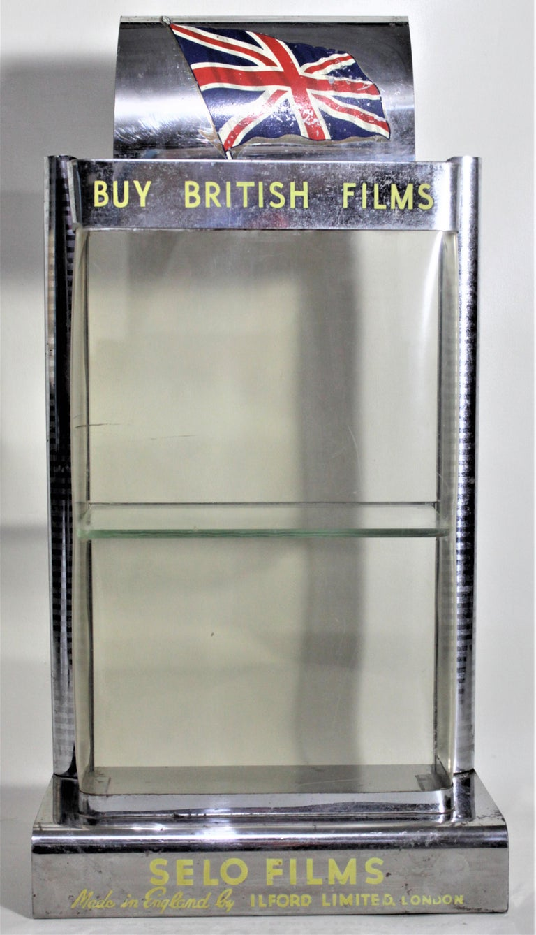 This store display was made for the English film manufacturer, Ilford to advertise their Selo film line during the 1960s in the period Mid-Century Modern style. The frame of the display is done in chromed metal with a molded plastic window. The top