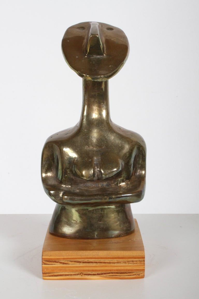 Unique Mid-Century Modern African cubist bronze sculpture of a nude female, heavily influenced by Pablo Picasso's early cubist work using African masks. Unsigned. In very nice condition. Sculpture only, not on wood base measures 8.63