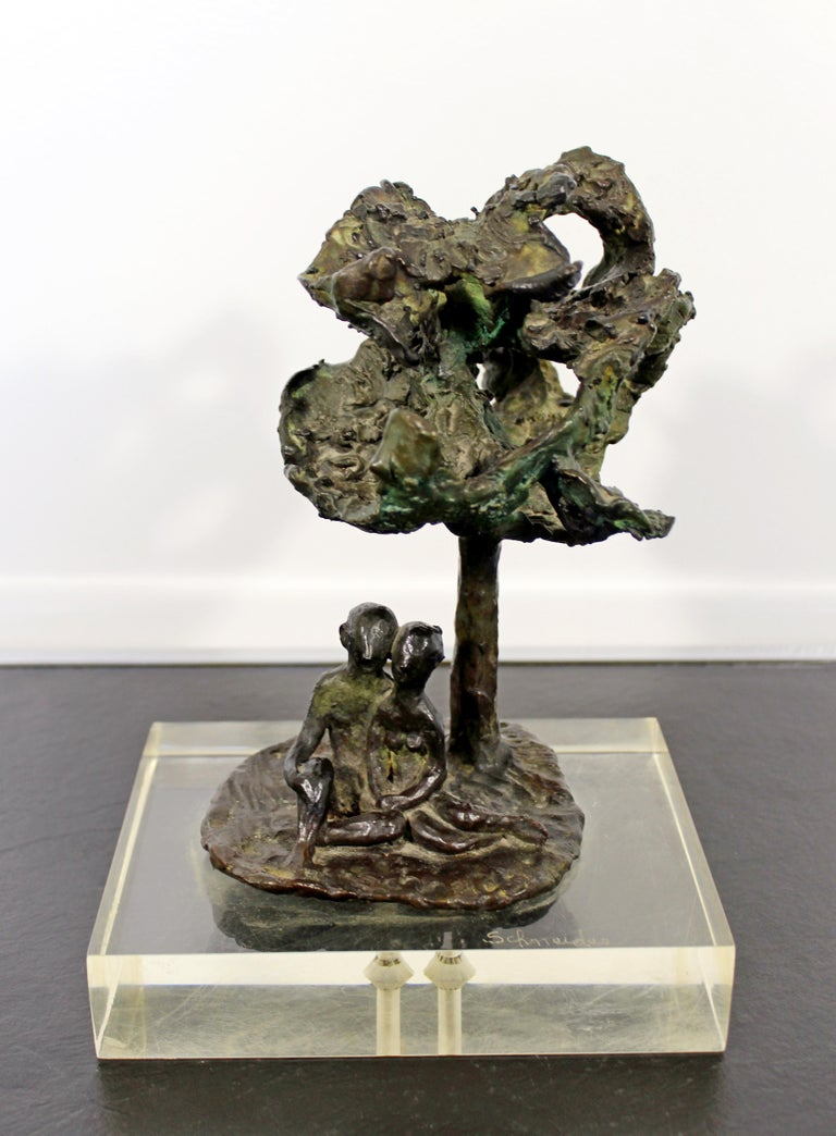 For your consideration is a marvelous art sculpture of figures under a tree, made of bronze on a Lucite base, signed by Arthur Schneider, circa the 1970s. In excellent condition. The dimensions are 7.5