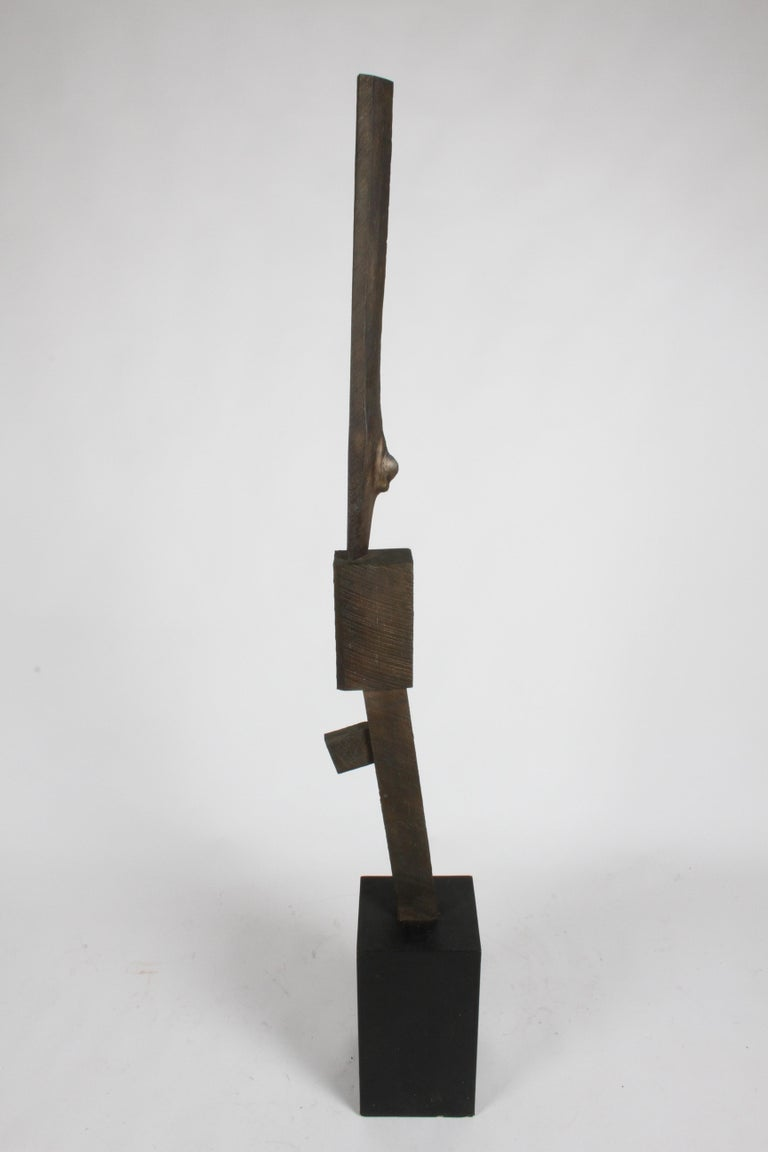 Stunning Mid-Century Modern Brutalist TOTEM bronze sculpture in the style of artist Joel Shapiro. Cast in bronze, the sculpture takes on the surface or texture of the wood grain and knots from the lumber that was used to make it. Applied patina to