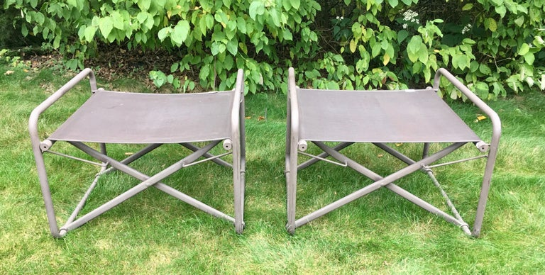 Pair of sculptural Mid-Century Modern Brown Jordan Original Nomad collection ottomans, circa 1970s. Features original brown colored powder-coated aluminum/metal frames with brown mesh fabric. These folding Campaign style benches can be used as