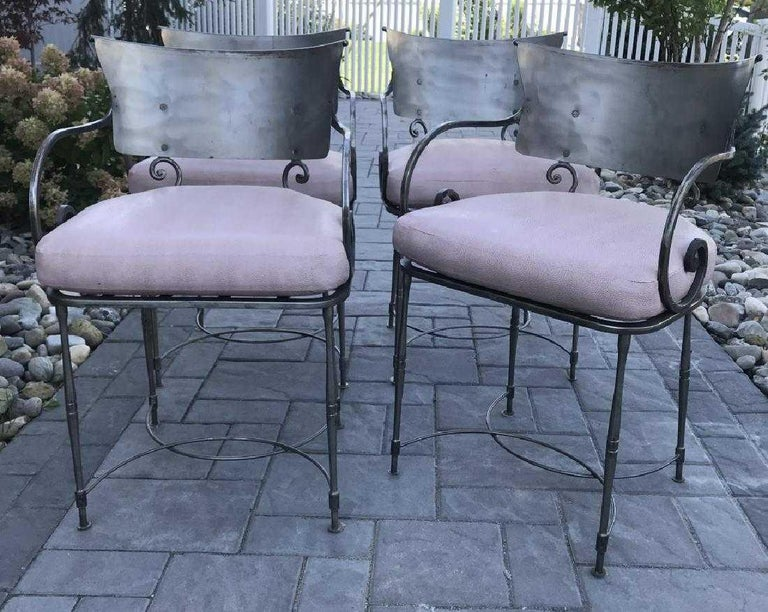 Mid-Century Modernist yet classically styled vintage wrought iron indoor or outdoor, porch or patio dining chairs. The bold styling works well with Classic or modern sleek contemporary interiors. Scroll form arms, modernist back splat. Great form,