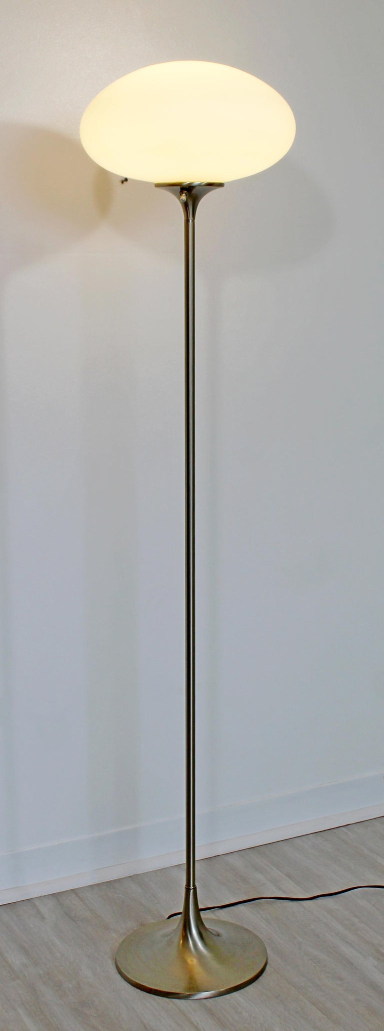 For your consideration is a wonderful, white glass and brushed steel, mushroom style floor lamp, by the Laurel Lamp Co., circa 1970s. In excellent condition. The dimensions are 12
