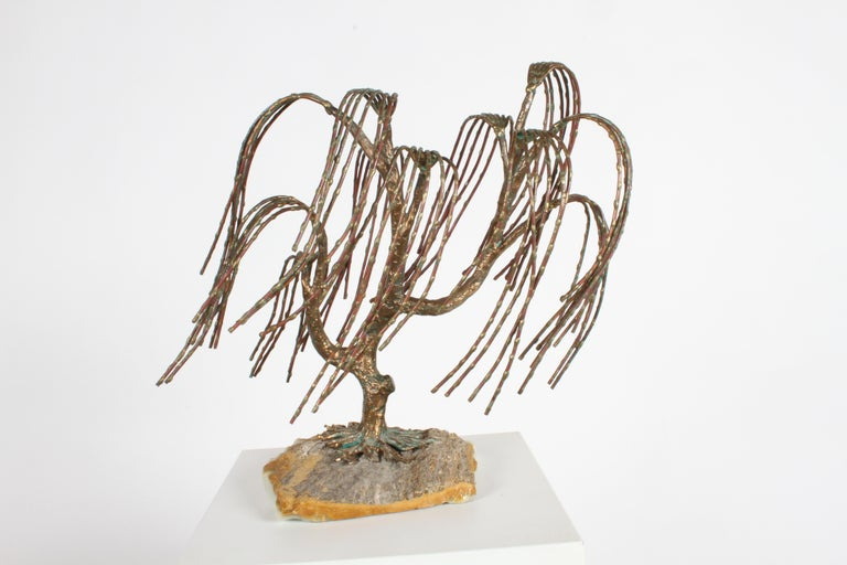 Mid-Century Modern bronze sculpture by the international artist Bijan. Mounted on a natural piece of quartz, elegant weeping willow tree has 11 branches, with each branch having 6 separate weeping shoots. In addition to the bronze branches and