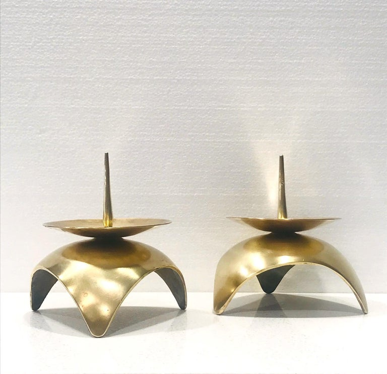 Pair of Japanese Mid-Century Modern candleholders in solid brass metal. Candlesticks have a Brutalist inspired design with spherical base and stylized spike and center dish. Ultra modern and gorgeous from all angles.