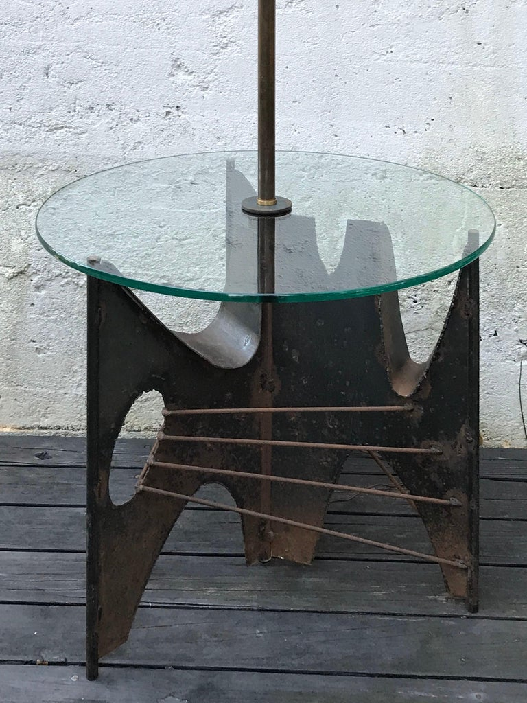 Very cool Brutalist sculptural floor lamp by Richard Barr for Laurel Lamp Co.  Welded metal base with aged patina, clear round glass table top. Shade not included.