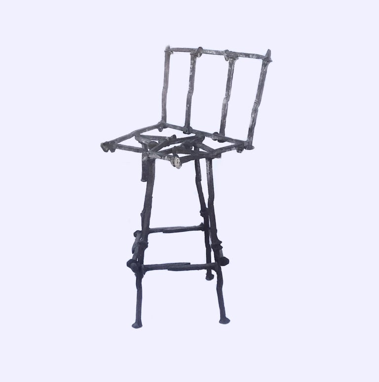 Mid-Century Modern Brutalist railroad spikes chair sculpture.  This very unique sculpture is made from reclaimed vintage railroad spikes. It is fashioned with welded steel spikes into a rustic chair sculpture. The handcrafted original design is of