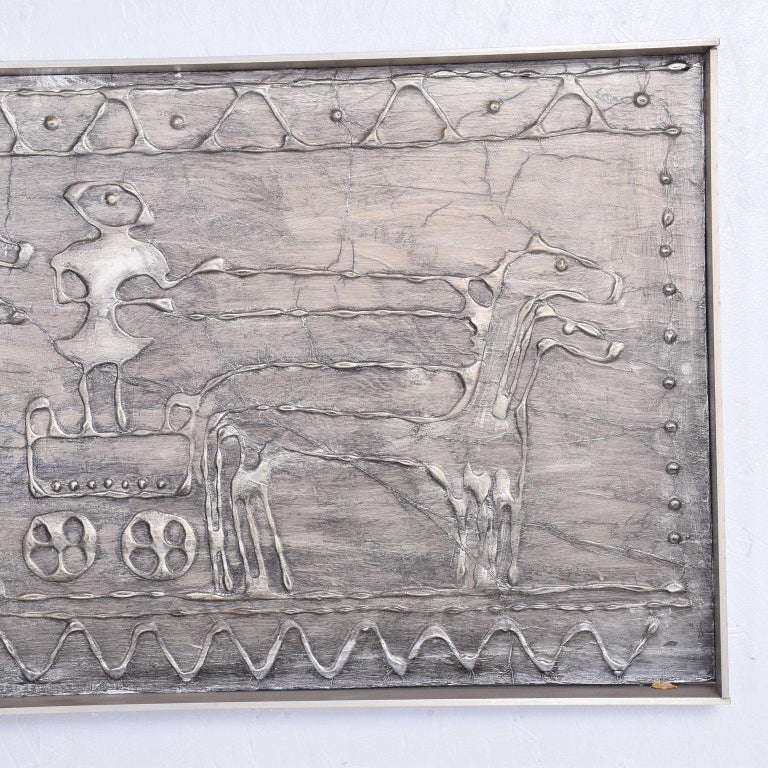 For your consideration a Mid-Century Modern wall plaque Brutalist/abstract style. Beautiful patina. Original frame in aluminum.  Measures: 16 3/8