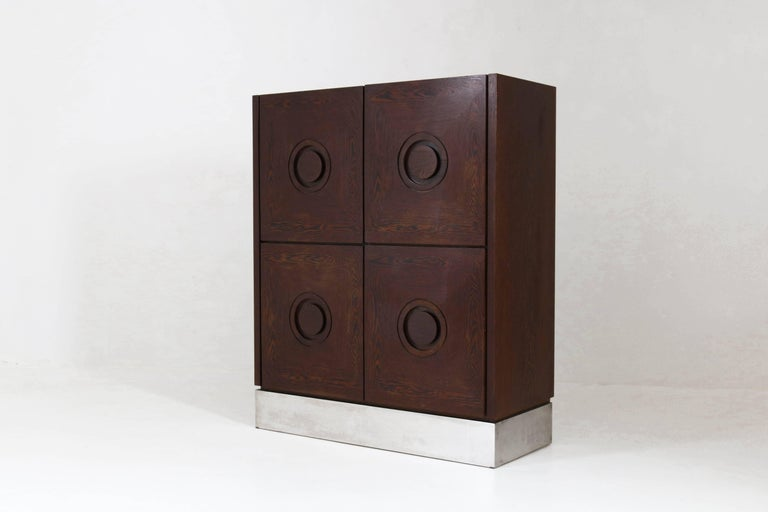 Stunning Mid-Century Modern Brutalist Belgium bar cabinet, 1970s. Wengé with graphical door panels and metal lining. This striking piece of furniture was purchased at the famous Amsterdam department store De Bijenkorf during the 1970s. In good