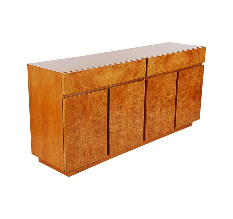 A beautiful 4-door credenza designed by Milo Baughman for Lane. This piece features solid wood construction with bookmatched burl maple veneers.
