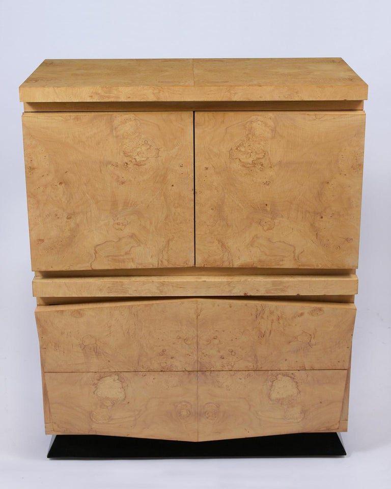 A midcentury chest of drawers crafted out of maple wood and covered in an exotic bird-eye burled veneers and is newly restored. The dresser is eye-catching features an extraordinary fresh clear and ebonized lacquered finish. The piece comes with two