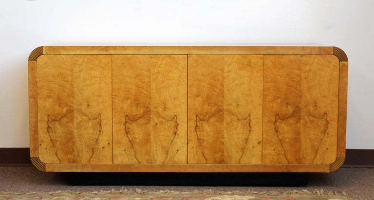 For your consideration is a magnificent credenza, made of burled wood and with ebony trim, with four doors and two shelves, from Henredon's Scene Two Collection, circa 1970s. In very good condition. The dimensions are 60
