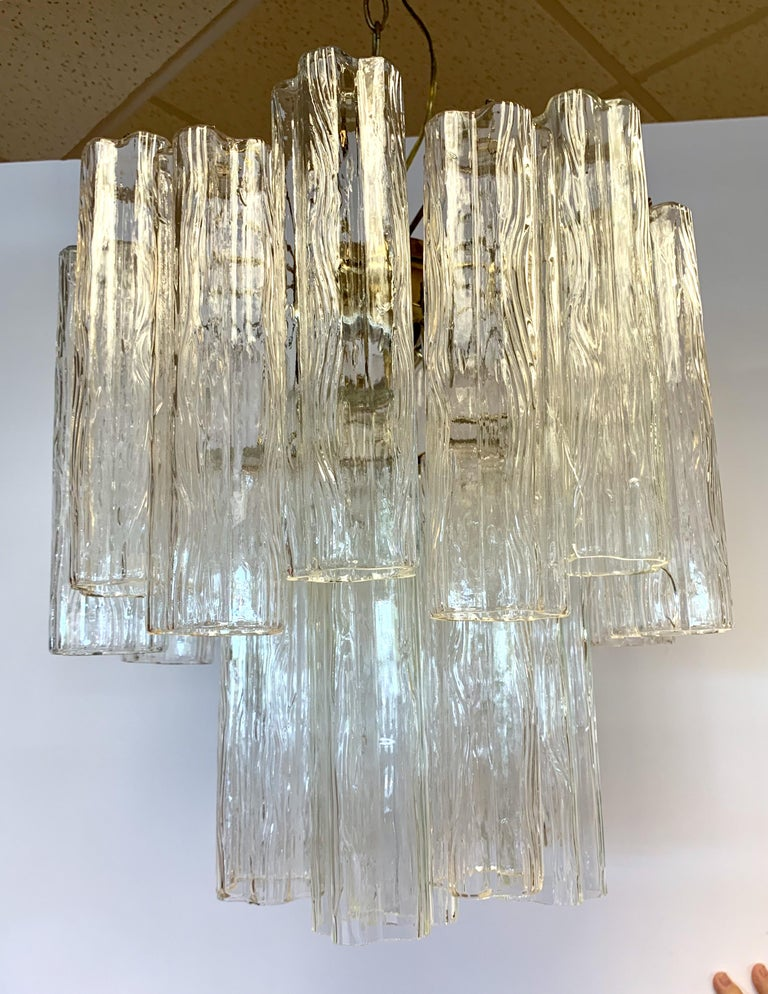 Mid-Century Modern venini glass chandelier is made of textured glass tubes that look like flowers when looked at from below. Made in Italy. Wired for USA and in perfect working order.