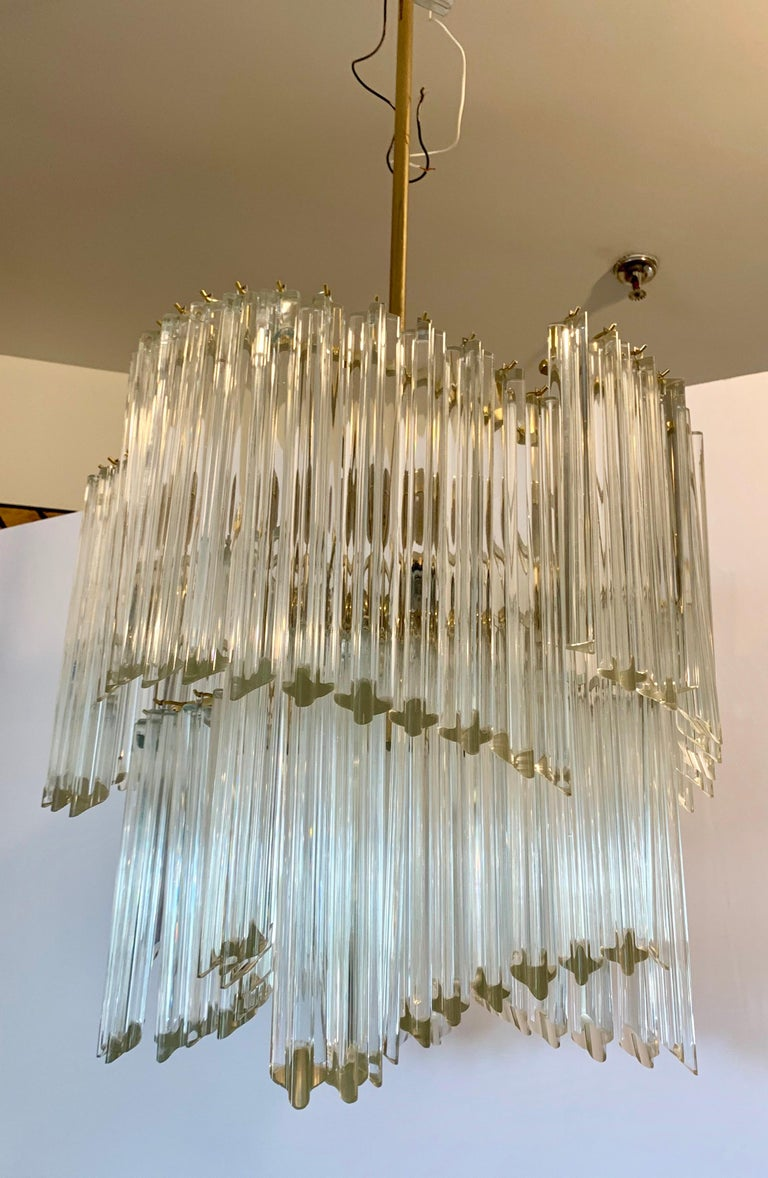 Magnificent midcentury 1970s Camer glass large chandelier with Murano glass prisms hung in a descending spiral waterfall. Wired for USA and in perfect working order with five light sockets.