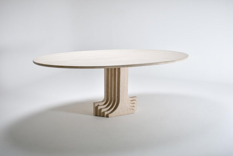 Mid-Century Modern oval travertine dining room table. 