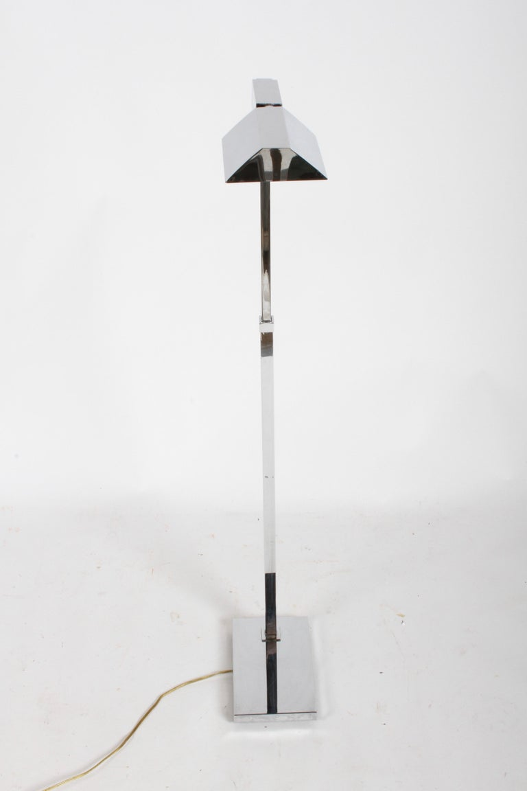 Mid-Century Modern Casella of San Francisco, chrome fully adjustable floor reading lamp on rectangular base. Shade is adjustable, along with up and down positions and 360° side motion. Adjust from 34.25