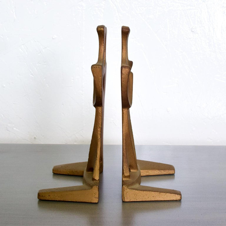 For your consideration, a Mid-Century Modern cast iron sculptural bookends. Stamped: