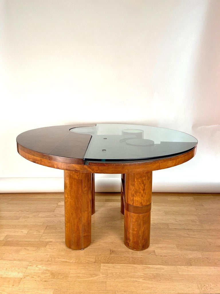 An sculptural and unique dining/center hall table. Designed by Nerone and Patuzzi and edited by NP2 Group . Walnut structure and glass and wooden top on four wooden legs ended by wooden and brass finishings, circa 1970.Excellent condition. A