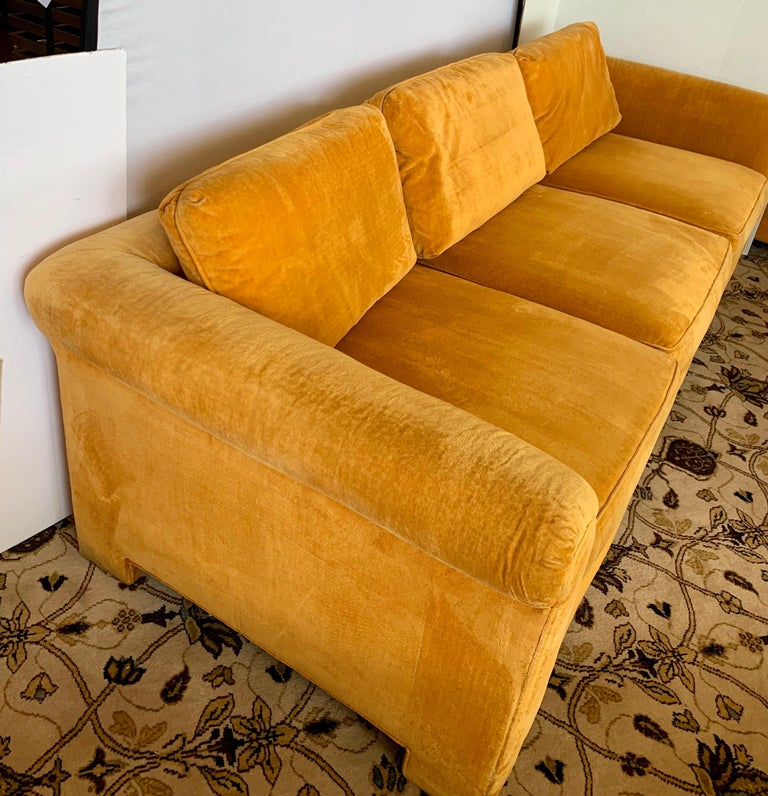 Rare and coveted signed Century Furniture sofa with original Hermès orange colored velvet fabric. The fabric is original and still in decent condition with normal age appropriate wear. The seats sit a little on the less firm side and the sofa is