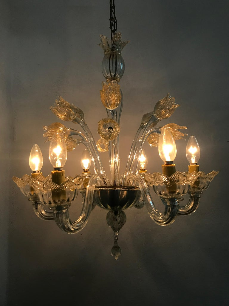 Mid century six light chandelier manufactured in clear Murano glass with gold inclusions, the manufacture of this chandelier is attributed to Barovier e Toso and is also very similiar to Andre Arbus' Designs, circa 1950.