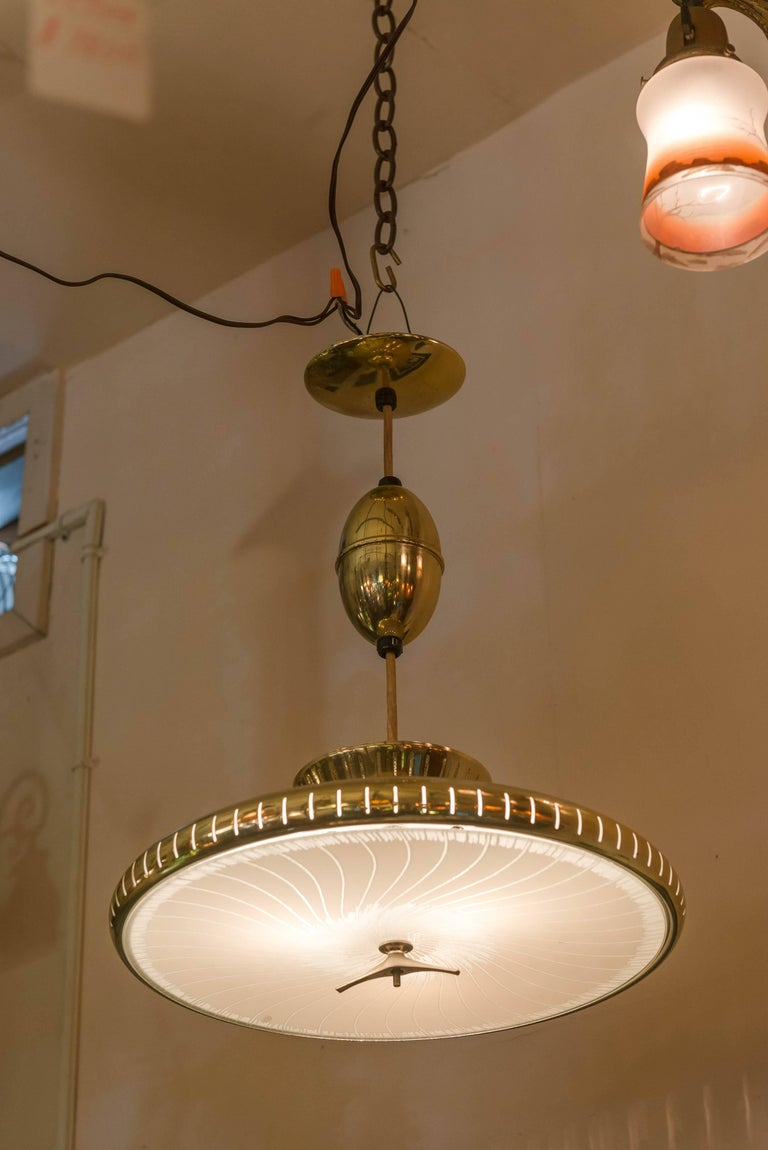 We usually sell older chandeliers, but this one really appealed to us. We actually found a photo of the T.V. show