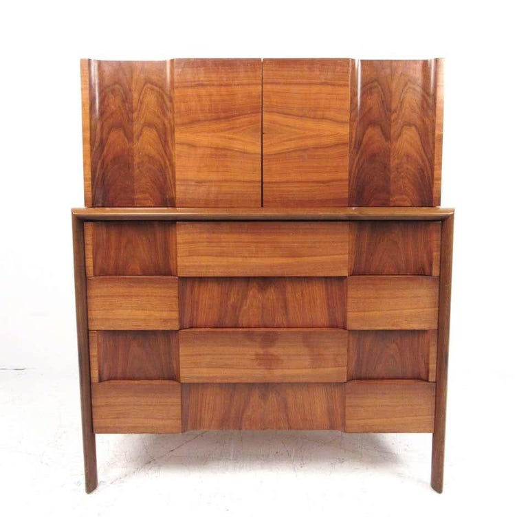 This stunning sculpted front pair of dressers by Edmond Spence features the stylish