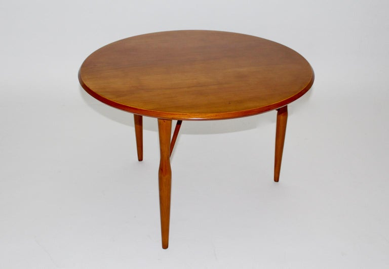 We present an elegant coffee table made of honey colored cherrywood by Josef Frank for Svenskt Tenn attributed, Sweden 1950s. The coffee table features three round bars, that have the task for fixing the table and also for decoration. Furthermore