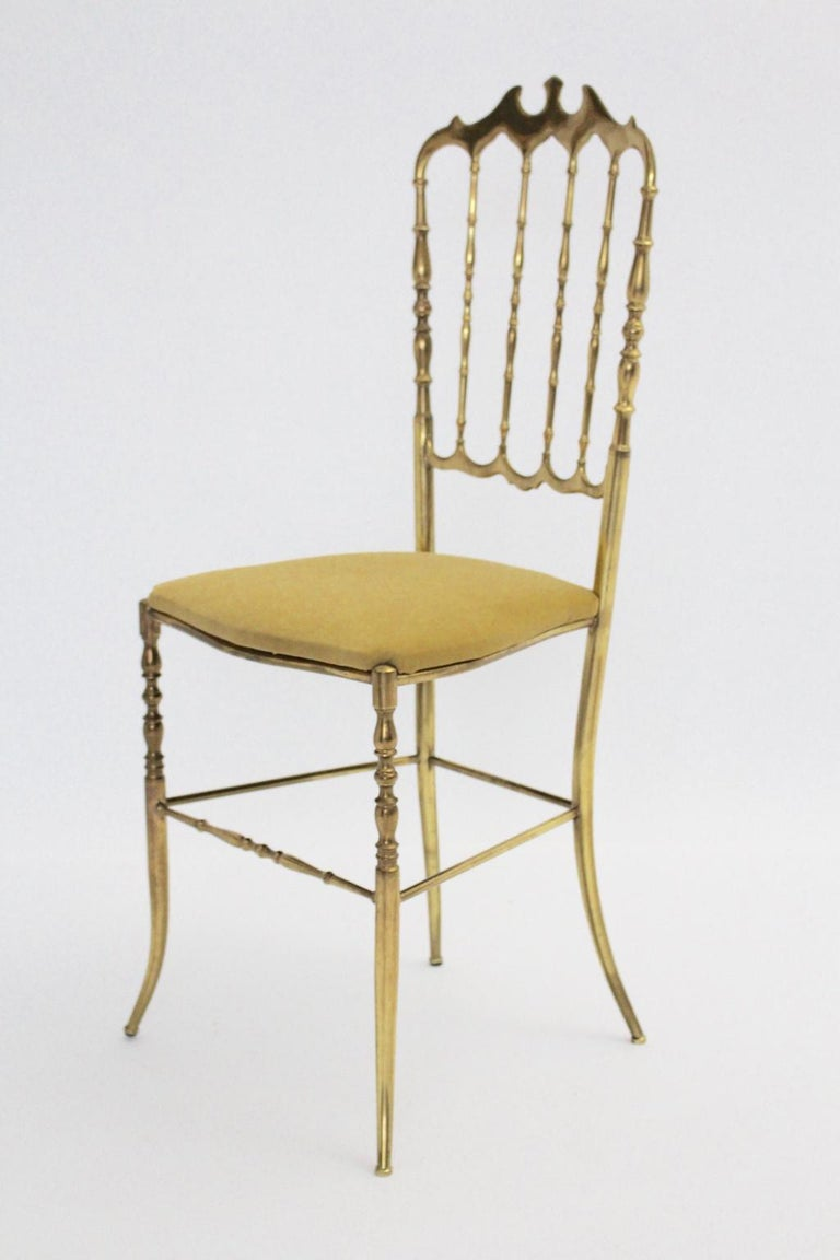 We present a delicate brass Chiavari side chair with renewed yellow velvet fabric. Also the brass side chair shows a beautiful brass patina. The condition is very good with minor signs of age. Approx. measures: Width 38 cm Depth 40 cm Height