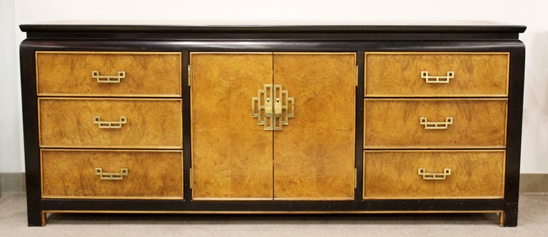 For your consideration is an incredible, Chin Hua oriental style dresser credenza sideboard, made of burl wood and brass, and matching pair of wall mirrors, by Century Furniture, circa 1970s. In excellent vintage condition. The dimensions of the