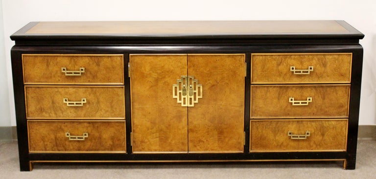 For your consideration is a luxe looking, Chin Hua oriental style dresser credenza sideboard, made of burl wood and brass, with nine drawers, by Century Furniture, circa 1970s. In excellent vintage condition. The dimensions are 76