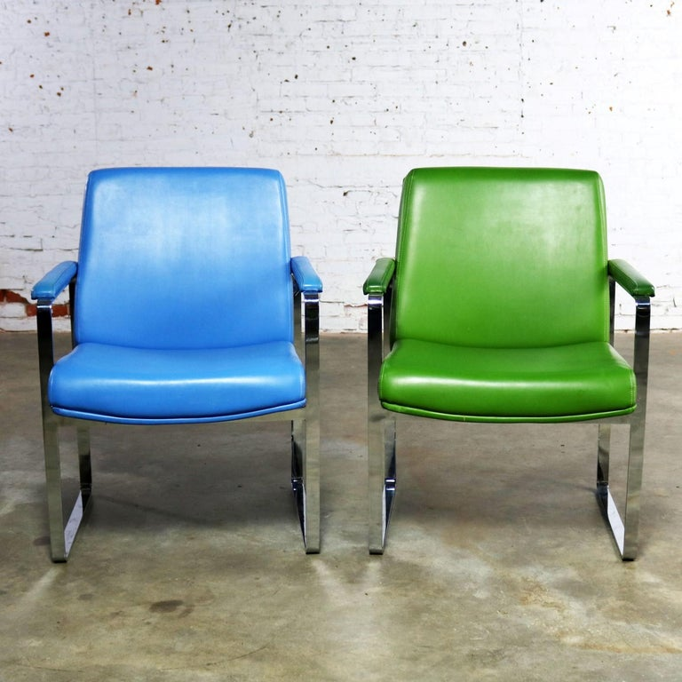 Wonderful Chromcraft Mid-Century Modern flat-bar chromed steel chairs one in cornflower blue vinyl and one in grass green vinyl. The chrome is in fabulous condition. The vinyl upholstery is in wonderful condition apart from several small nicks that