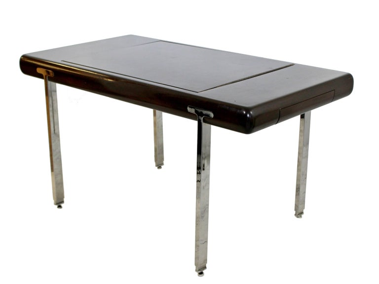 For your consideration is a phenomenal, chrome and lacquered wood, console table or desk, in the style of Pace or Brueton, circa the 1970s. The top flips over to make a desk or game table. The Dimensions are 28.25