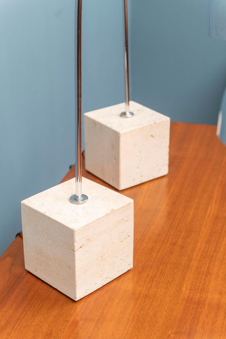 Pair of Mid-Century Modern Harvey Guzzini design chrome and travertine arc table lamps, Italy.