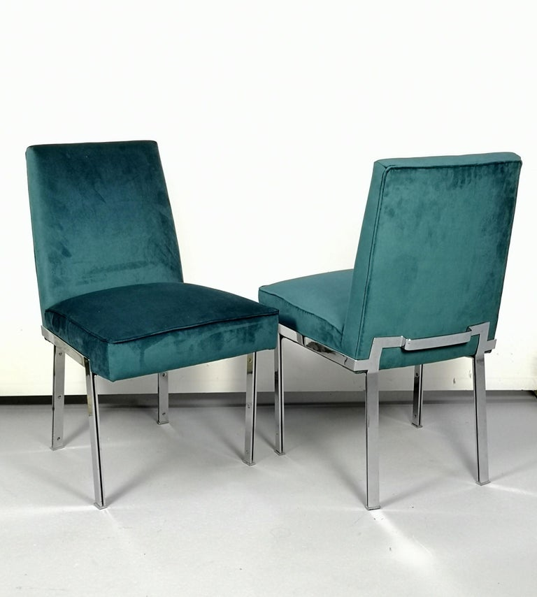 Fully re-upholstered with a turquoise high quality velvet, these heavy, chrome-plated steel chairs are of excellent design.