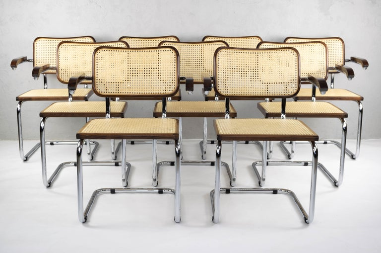Chairs model Cesca B64, with armrests. Chromed tubular structure, beechwood frames in walnut color and Viennese natural grid. Excellent condition in general both of the wooden frames, their natural fiber grids and the chromed structures.  Nine
