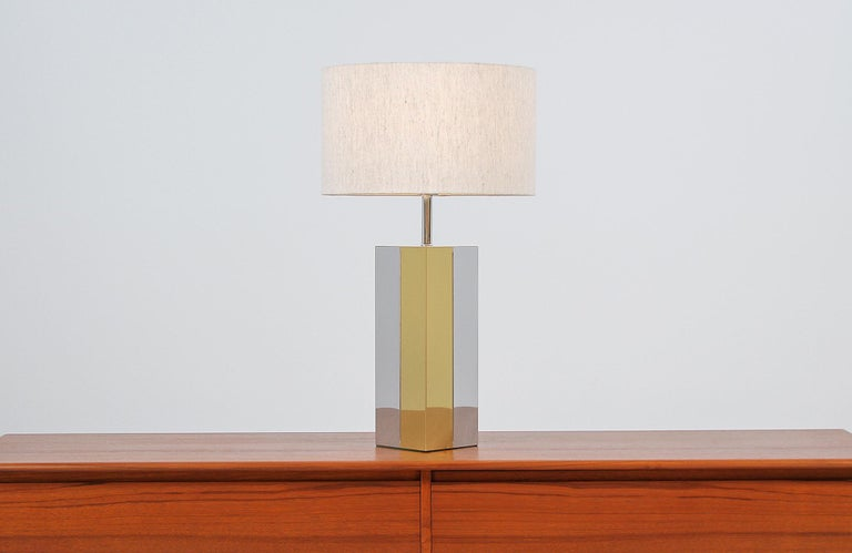 Dazzling modern table lamp designed and manufactured in the United States, circa 1960s. This unique and elegant lamp features a tall chrome and brass plated rectangular body in vertical panels on this Minimalist and geometric design. The plated