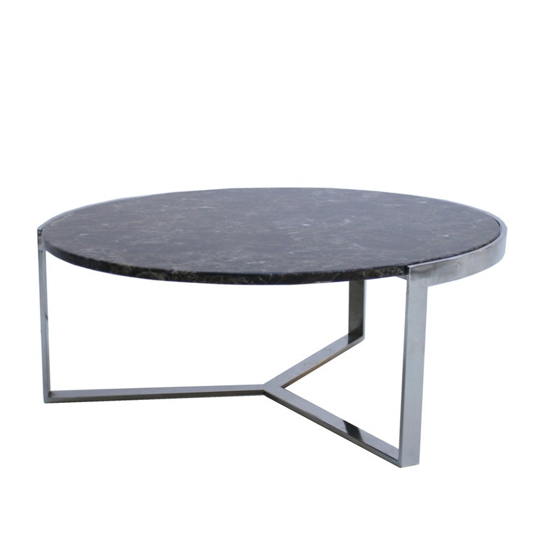 Circular marble coffee table made of emperador dark marble top and steel plate base structure, France, 1970s.