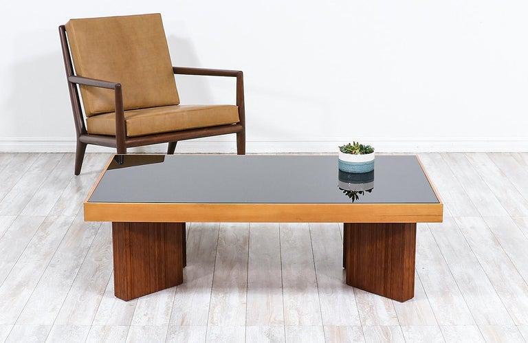 Mid-Century Modern coffee table with smoke glass top.