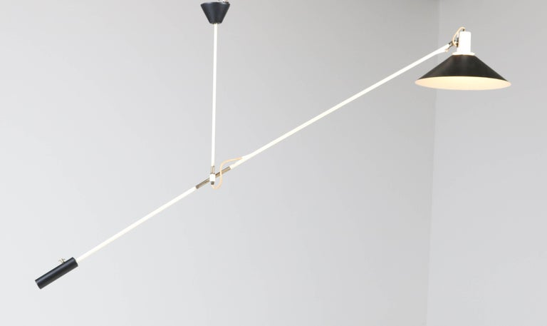 Wonderful Mid-Century Modern counter balance ceiling light. Design by J.J.M. Hoogervorst for Anvia. Striking Dutch design from the 1950s. In good original condition with minor wear consistent with age and use, preserving a beautiful patina.