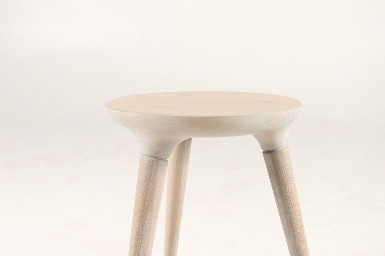 The three-legged Coventry Stool by Studio DUNN is handcrafted in New England from solid White Oak and finished with a Vintage White oil finish. Only 1 stool remains in this limited-edition series.  We hand mix and apply our custom finishes to each