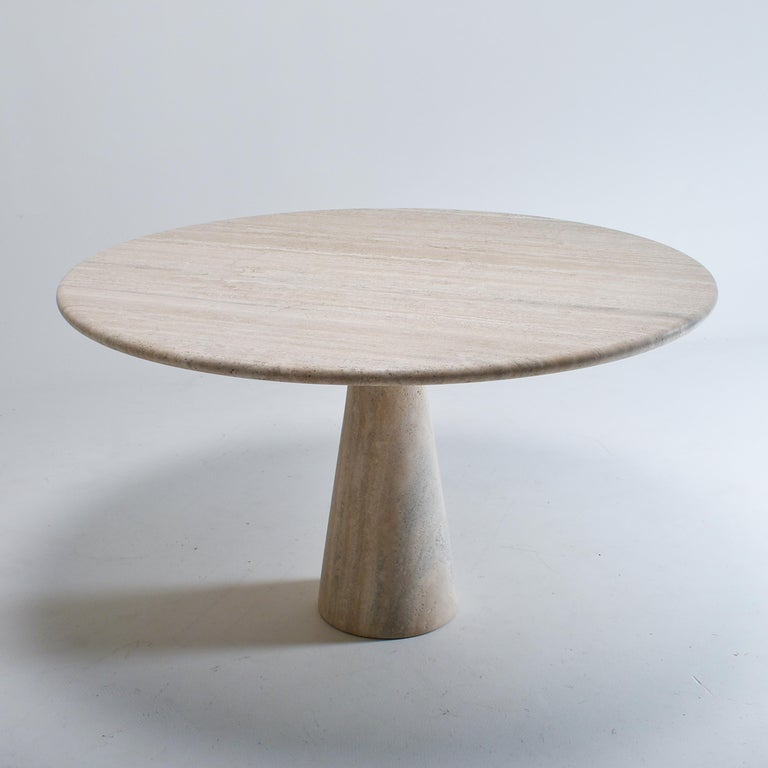 """Mid-Century Modern pedestal dining table, in cream travertine. Elegant central leg, nice top shape, pristine condition. The big tabletop, 127 cm (50"""") accommodates comfortably eight guests, and the central leg let free space for chairs and"""