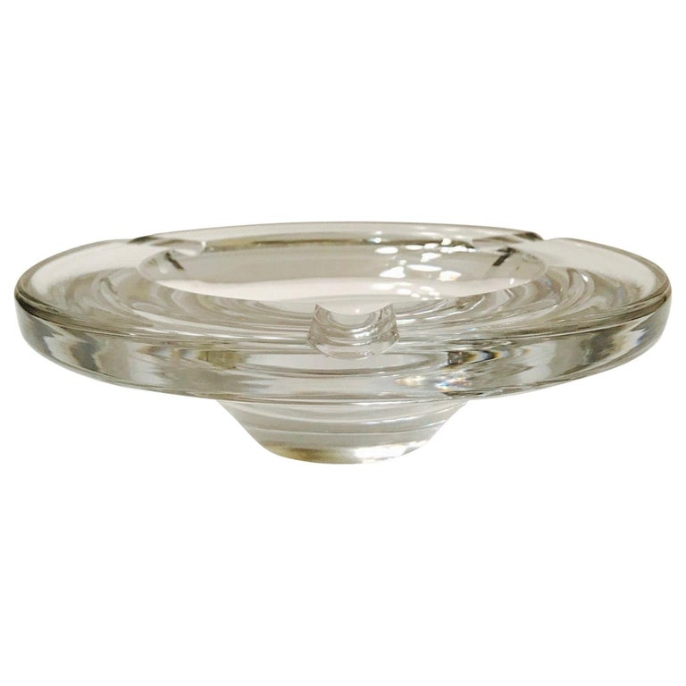 Gorgeous large and heavyweight cigar ashtray or decorative bowl in hand blown crystal. Ashtray has tapered streamline modernist design. Series # 71577. Signed Lindstrand for Kosta Boda.