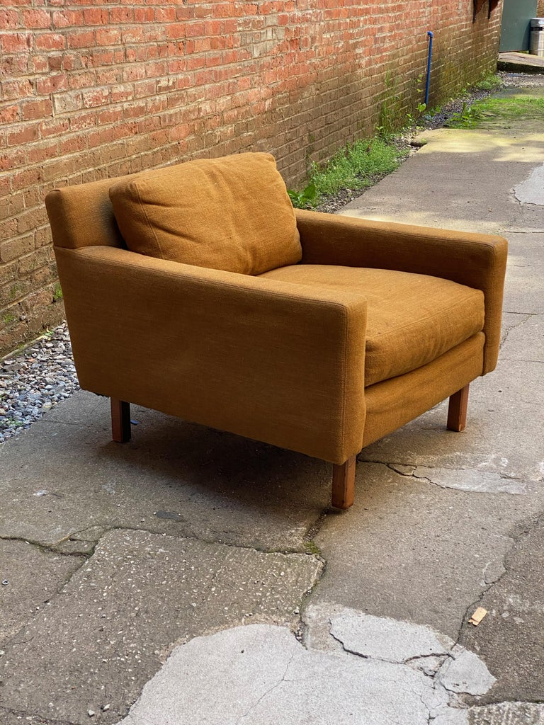 Maximum comfort with wide, deep seat. You sink into this chair. Structurally sound and sturdy armchair that came out of a fantastic apartment on West 94th Street, NYC. Original mustard colored wool upholstery. Overall staining on arms and cushions