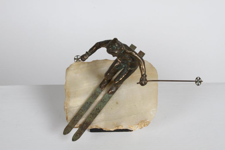A very cool bronze downhill skier sculpture on a solid block of onyx by C. Jere, circa 1960s. The piece is signed