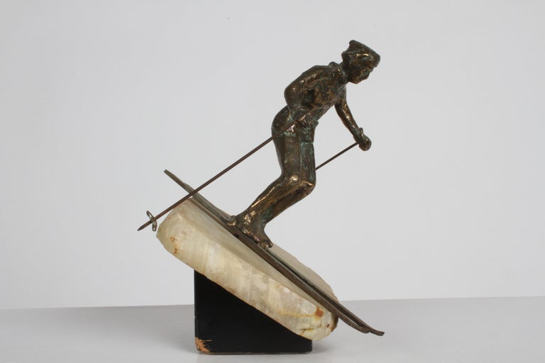 Mid-Century Modern Curtis Jere Bronze Downhill Skier Sculpture on Onyx Base In Good Condition For Sale In St. Louis, MO