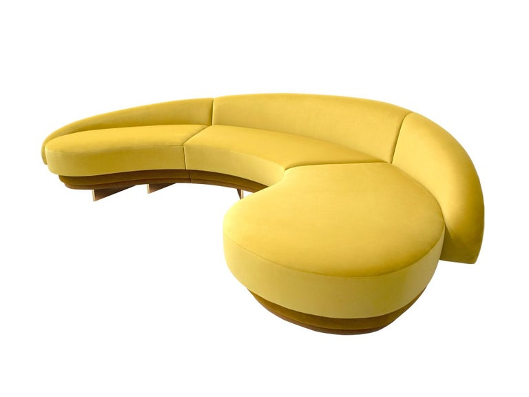 Giulia Sofa Giulia sofa is a mid-century style sofa. This luxury sofa promises to be the absolute protagonist of a living room project. Its Mid-Century Modern inspirations are reflected in its shapes, revealing an eclectic and luxurious
