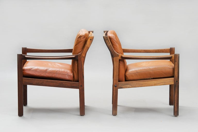 Mid-Century Modern Danish massive rosewood armchairs, one pair. This items are in original condition, can be sold as they are or fully restored.