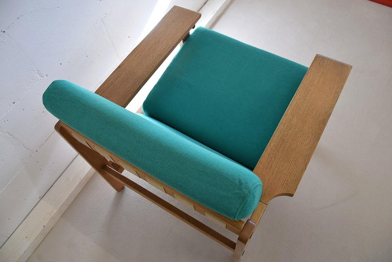 Danish Mid-Century Modern lounge set designed by Aksel Dahl in the 1960's.  Superior solid oak quality and construction in excellent condition with it's original upholstery. This set has been produced in the 70's.  This very comfortable set